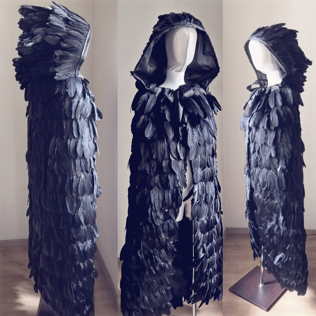 Feathered hooded cape. Solid black, goose feathers.
