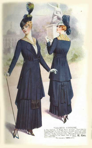 Advertisement for a long tailored navy blue dress, circa 1915.  Includes a matching hat!