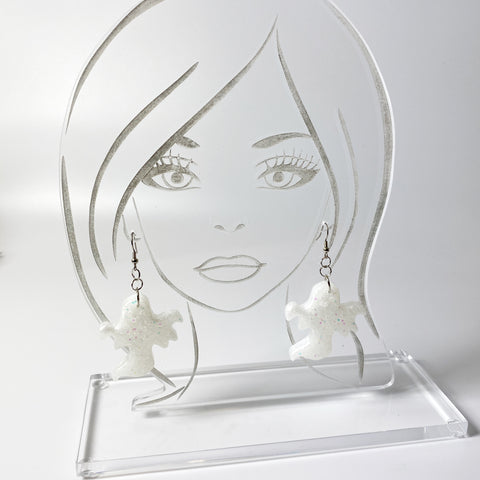 earring display head holding large white glitter resin earrings