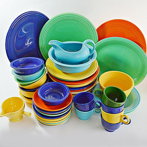 a large collection of vintage Fiesta dishes