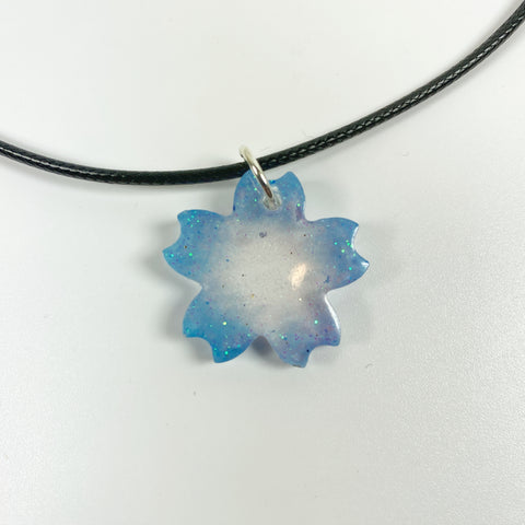 Blue Ombre Starflower Glittery Resin Pendent Necklace front view