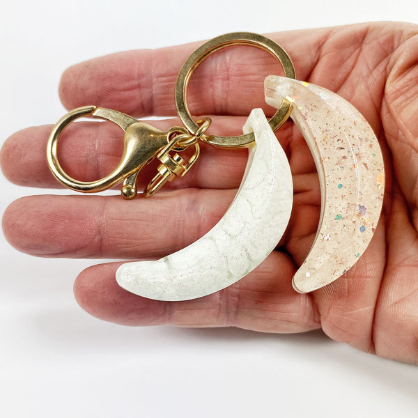 Blush and Cream Winter Twin Bananas Resin Charm Keyring handheld for size reference
