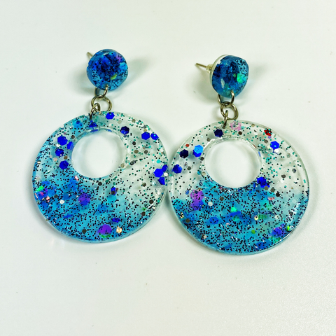 Diving from the Float earrings, tranparent hoop earrings shading from clear to deep lake blue