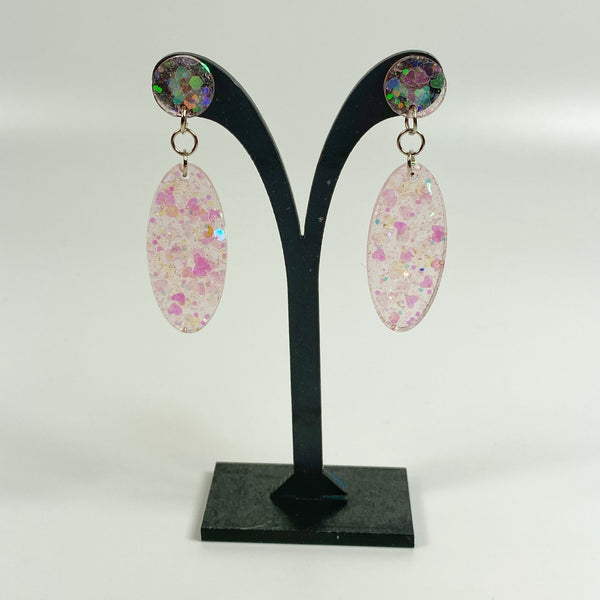 Blush Pink Glitter Resin Dangle Earrings on black earring display stand