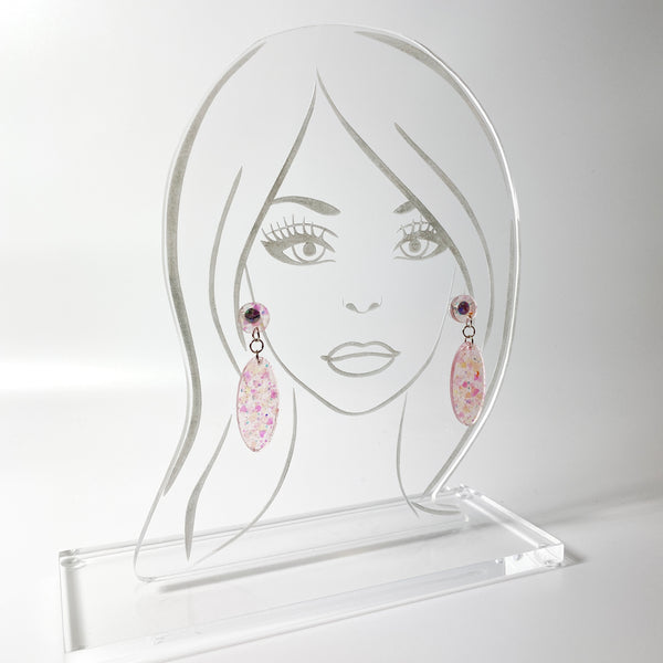Blush Pink Glitter Resin Dangle Earrings on acrylic earring display model