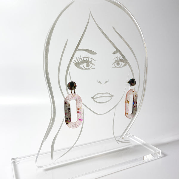 Blush and Black Oval Hoop Dangle Resin Earrings on acrylic display model head