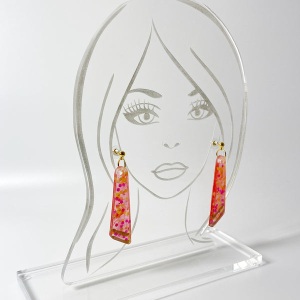 Pink and Gold Long Sparkle Dangle Resin Earrings on clear acrylic display head