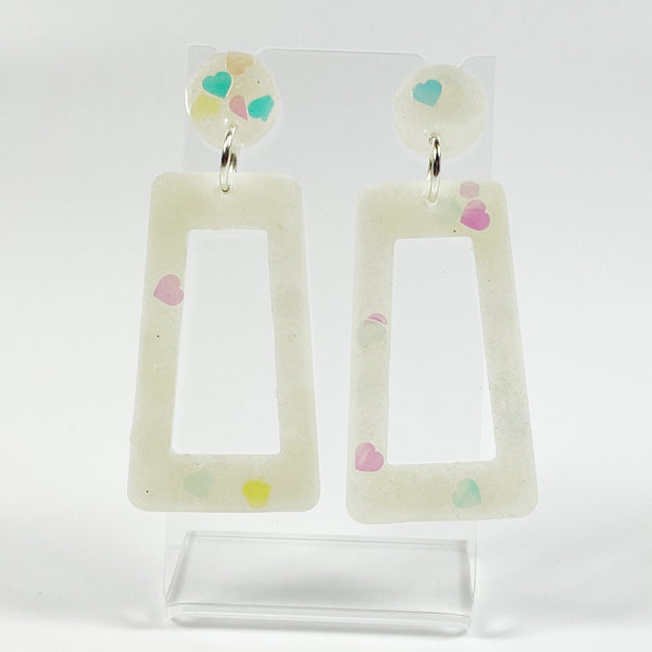 E144 Milky White Opalescent Square Hoop Dangle Resin Earrings on small acrylic display stand