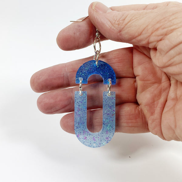 Double Dangle Blues Sparkle Hoop Resin Earrings hand held for size reference