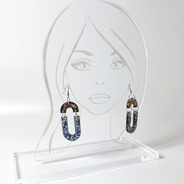 Double Dangle Brown and Black Starry Resin Hoop Earrings on acrylic display head