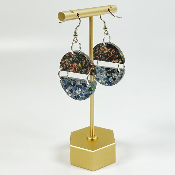 Black and Brown Double Dangle Resin Earrings with Silver and Gold on brass display stand