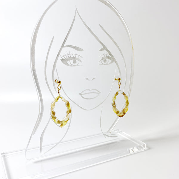 Amber and Brown Scallop Resin Hoop Dangle Earrings  on clear acrylic display head