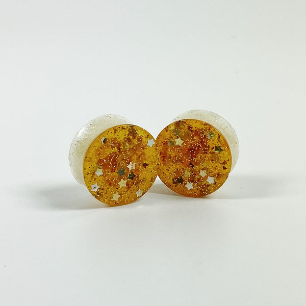 Golden Stars and Glitter over Opalescent Mica Resin Gauges Plugs front view standing