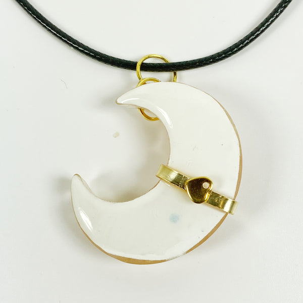Gold Banded Blush Sparkly Crescent Moon Resin Pendant Necklace back view with secret heart