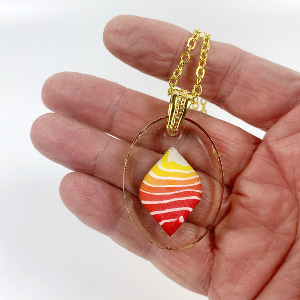 Stacked Bright Polymer Clay in Clear Resin Handmade Pendent Necklace handheld for size reference
