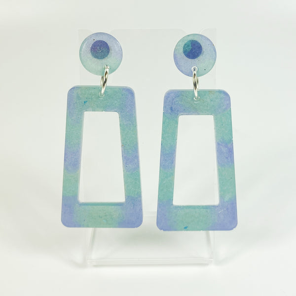 Blue and Purple Square Hoop Resin Dangle Earrings on small acrylic earring display stand