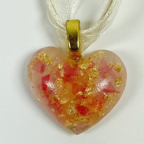 The Sweetest Heart of Scarlet and Gold Resin Necklace front view