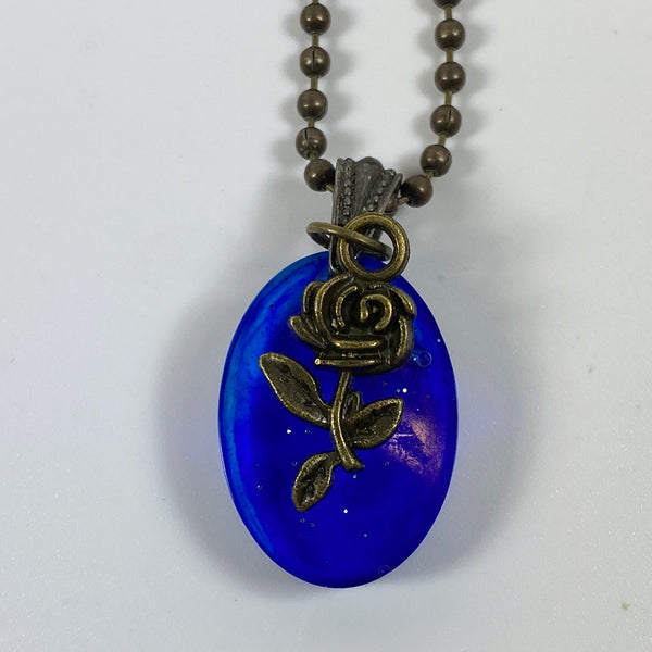 Deep Midnight Blue Resin Necklace with Bronze Rose Close up