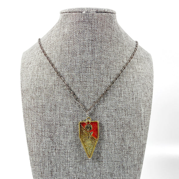 Red and Gold Pennant Resin Pendent Necklace with Bronze Rose on grey tweed display stand
