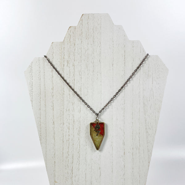 Red and Gold Pennant Resin Pendent Necklace with Bronze Rose on pale wood display stand