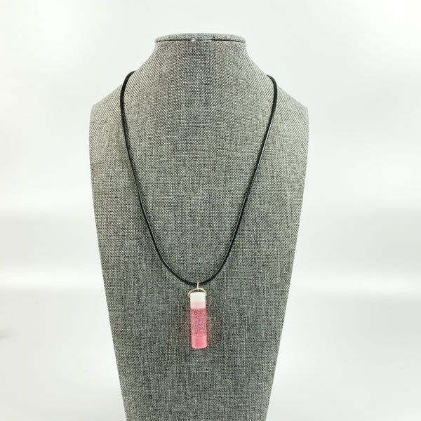 Pink and White Crystal Resin Necklace on grey tweed display stand