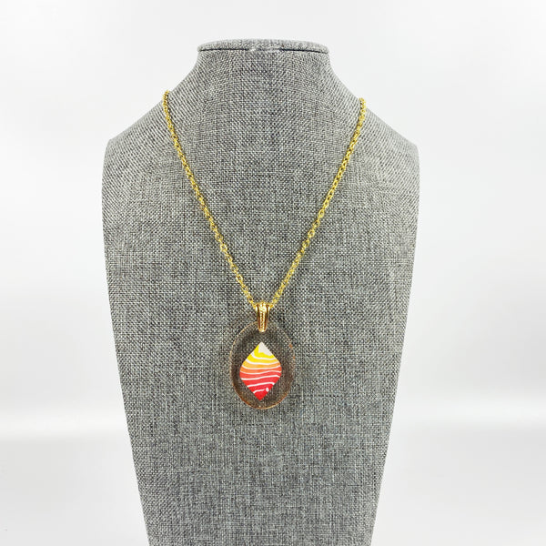 Stacked Bright Polymer Clay in Clear Resin Handmade Pendent Necklace on grey tweed necklace stand