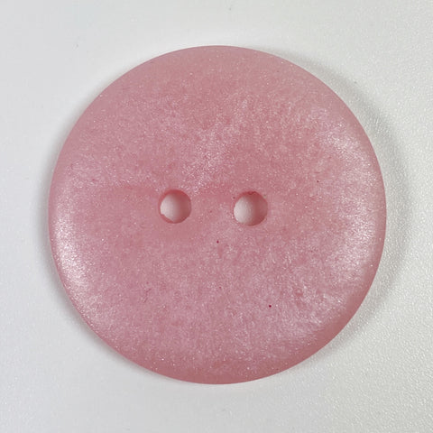 Opalescent pink button, top view
