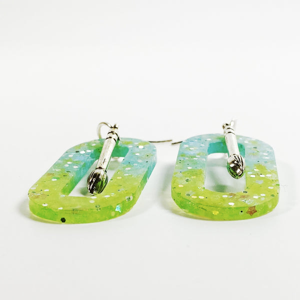 Northern Lights Oval Hoop Resin Earrings with Paint Brush Charm, side view