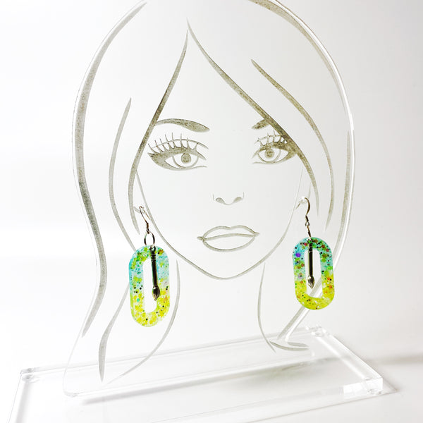 Northern Lights Oval Hoop Resin Earrings with Paint Brush Charm on acrylic models head