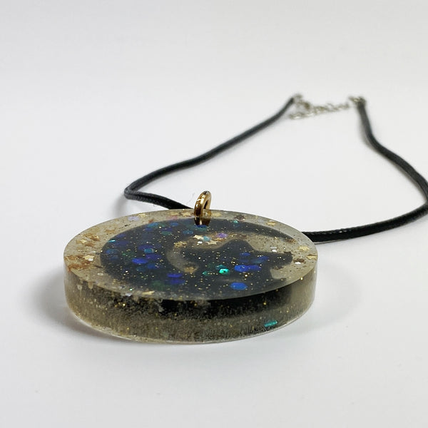 Black and Gold Moon and Star Resin Necklace side view