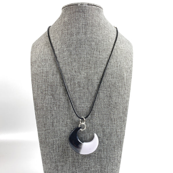 Crescent Moon Eclipse Resin Necklace on grey tweed necklace display stand