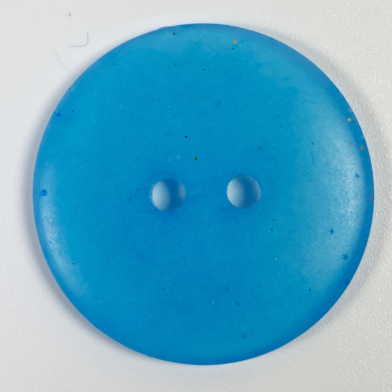 True Blue flat front resin button, top view