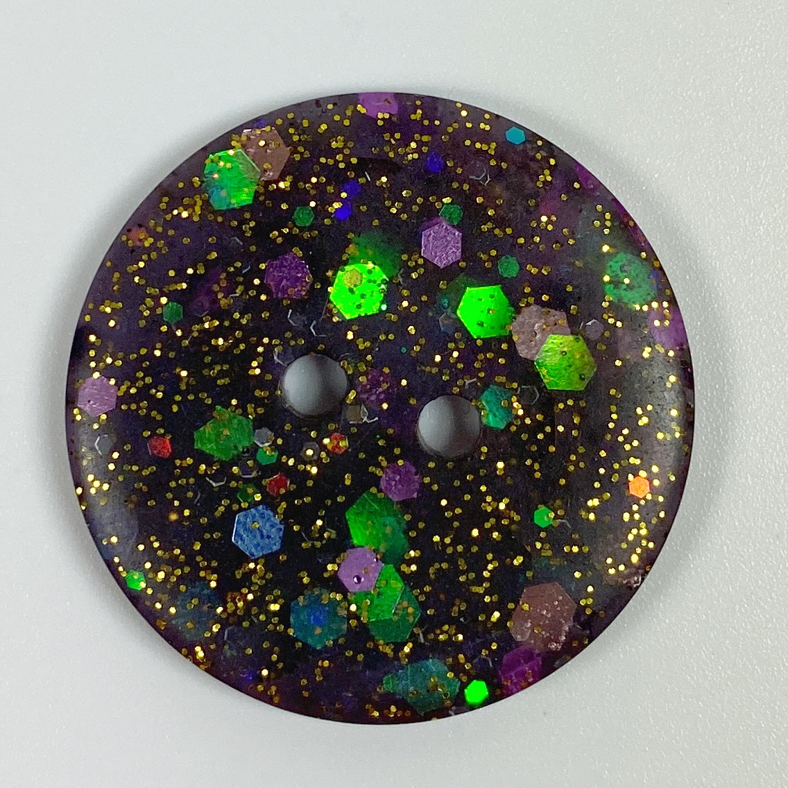Deep midnight plum flat resin button, top  view
