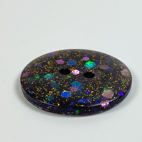 Deep midnight plum flat resin button, side  view