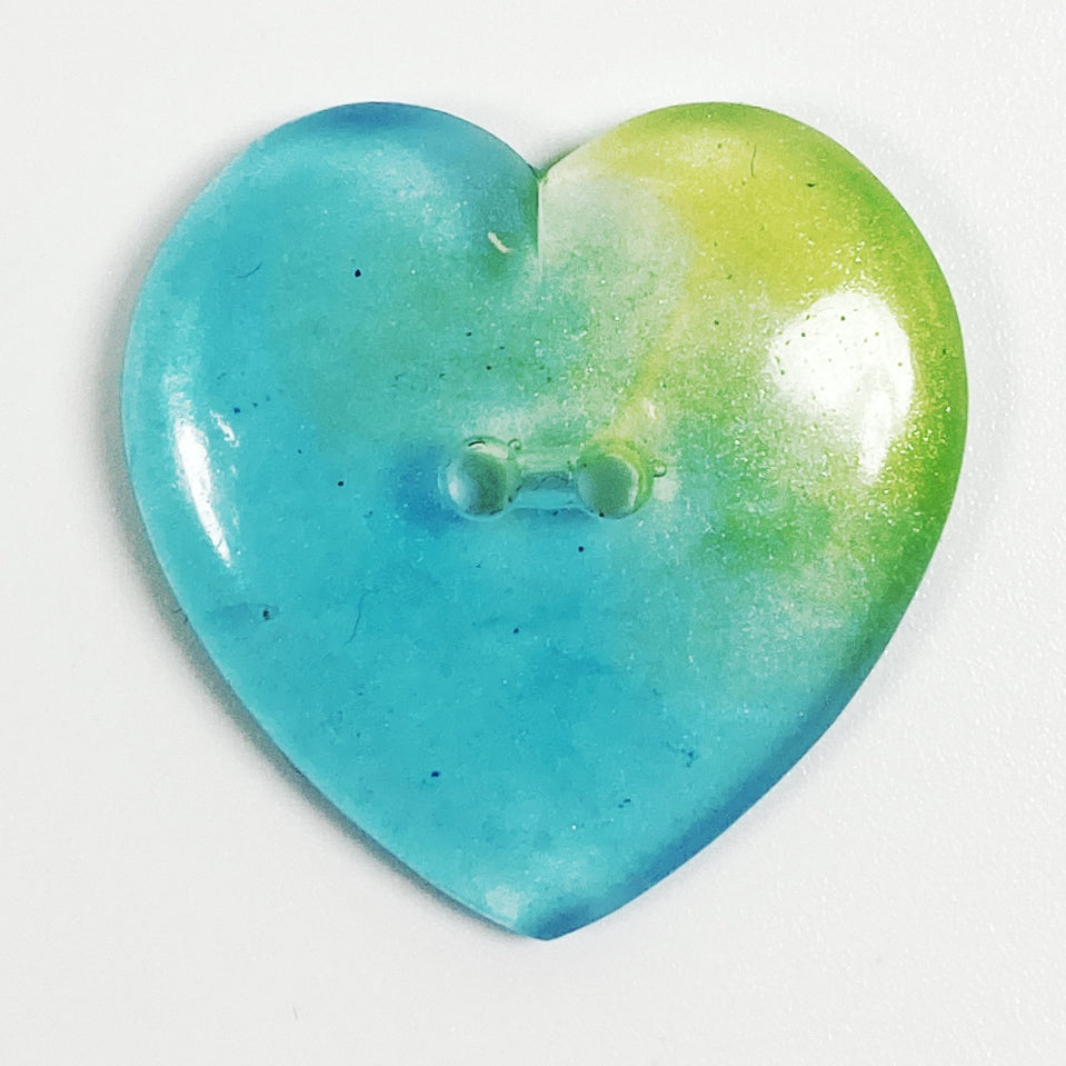 Aqua shading to green resin heart button, front view