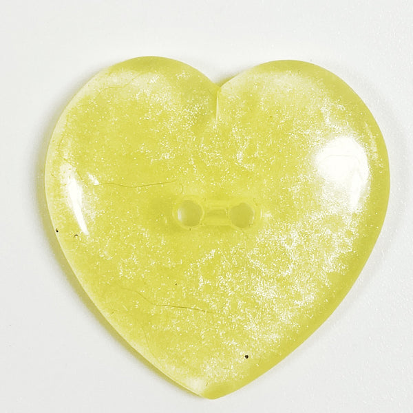 champagne colored resin heart button, front view