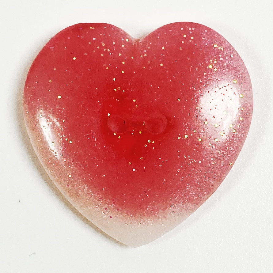 Strawberry and cream pink resin button, front view