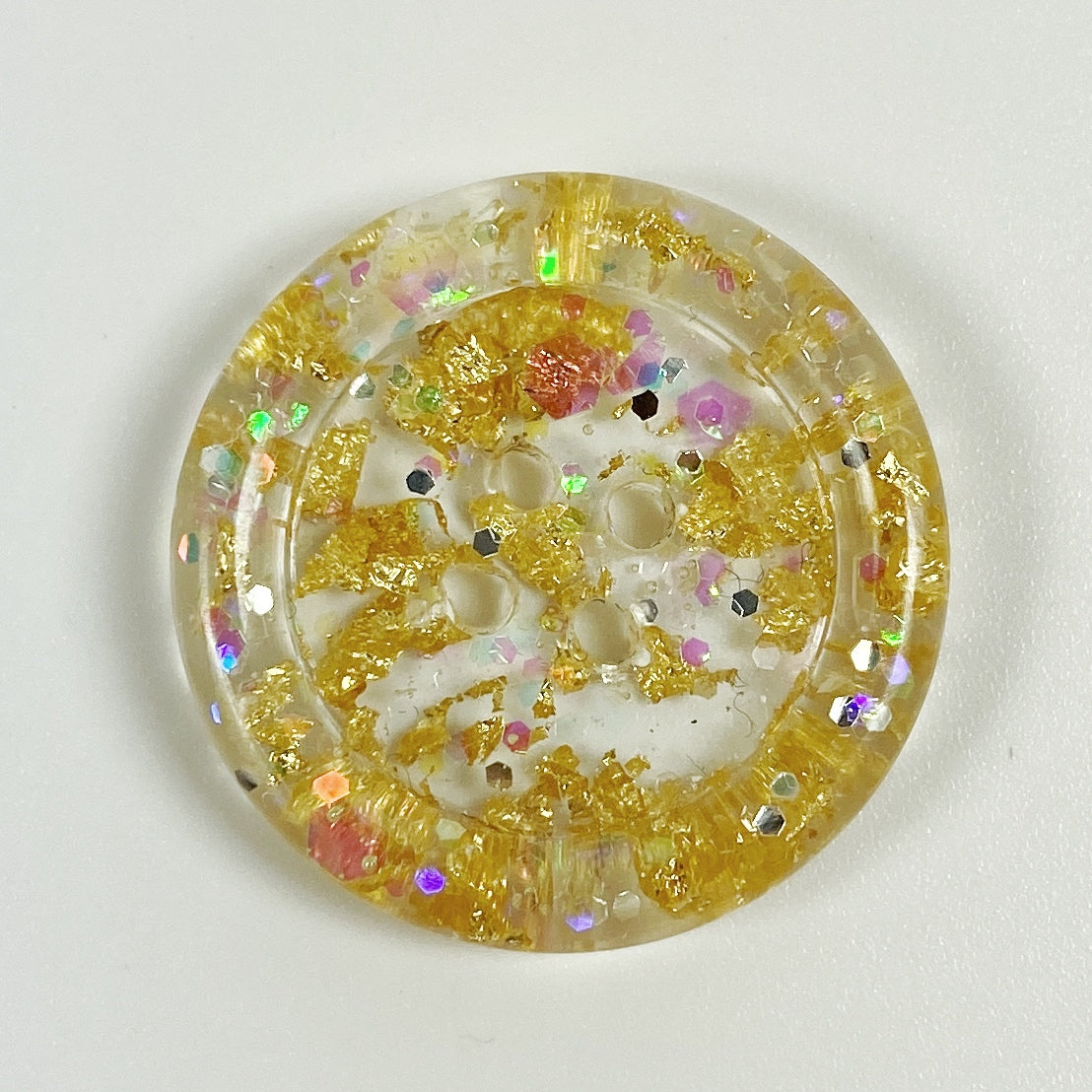 Gold Dust Rimmed Handmade Resin Button front view
