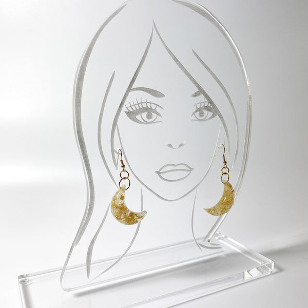 Pale Crescent Moon with Gold Flecks Resin Earrings shown on acrylic model head