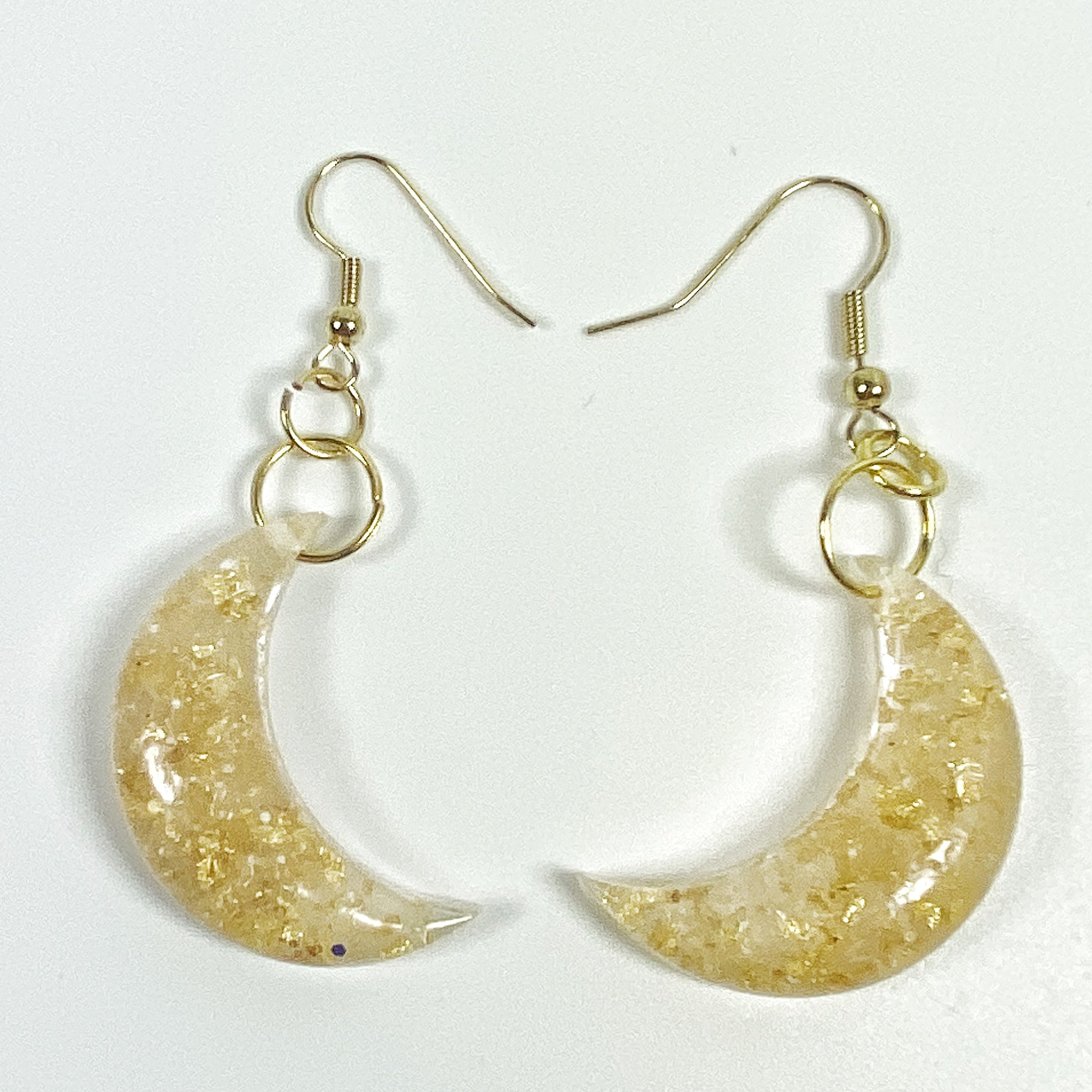 Pale Crescent Moon with Gold Flecks Resin Earrings front view