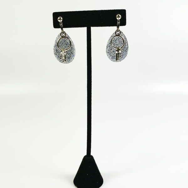 Blue Resin Crystal Resin Earrings with silver-toned key ring charm with keys on black earring display stand