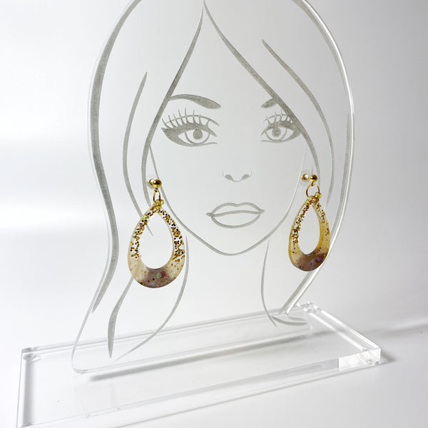 Pale Gold to Brown Sparkly Hoop Resin Earrings on acrylic display stand