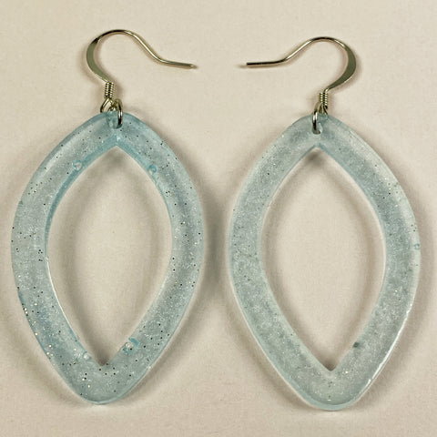 This pair of elongated hoop earring are pale aqua with glitter