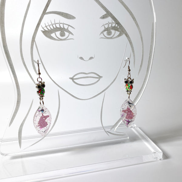 Owl & Unicorn Besties Resin Earrings on acrylic display head