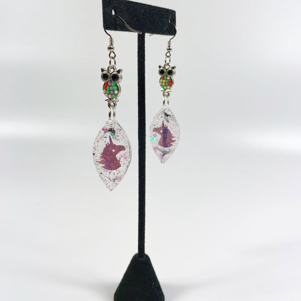 Owl & Unicorn Besties Resin Earrings on black earring stand