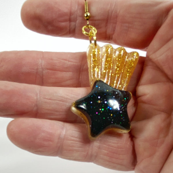 Deep Blue Comet Resin Earrings with Golden Tail handheld for size reference