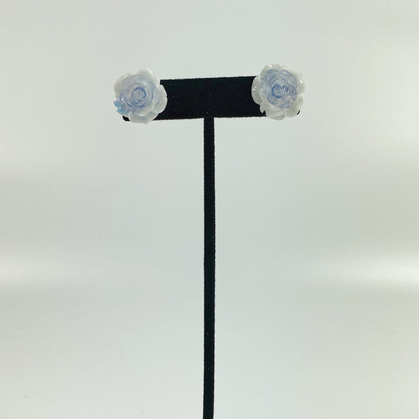 Blue and White Rose Resin Stud Earrings on black earring display stand