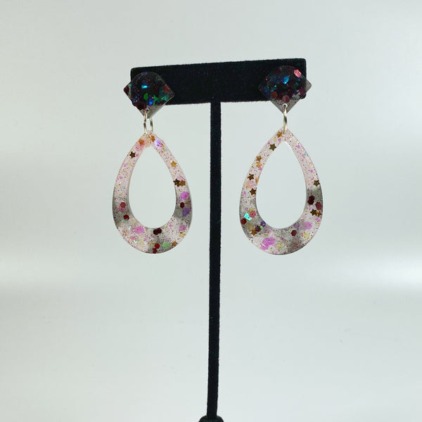 Blush and Ink Striped Resin Hoop Earrings on black earring display stand