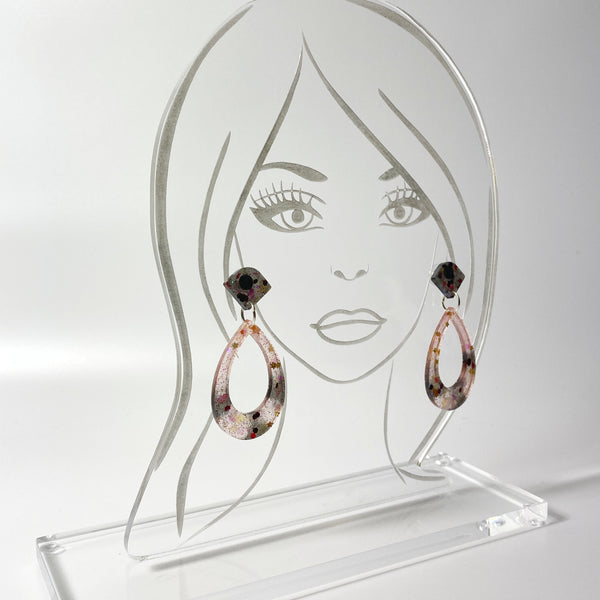 Blush and Ink Striped Resin Hoop Earrings on clear acrylic display head