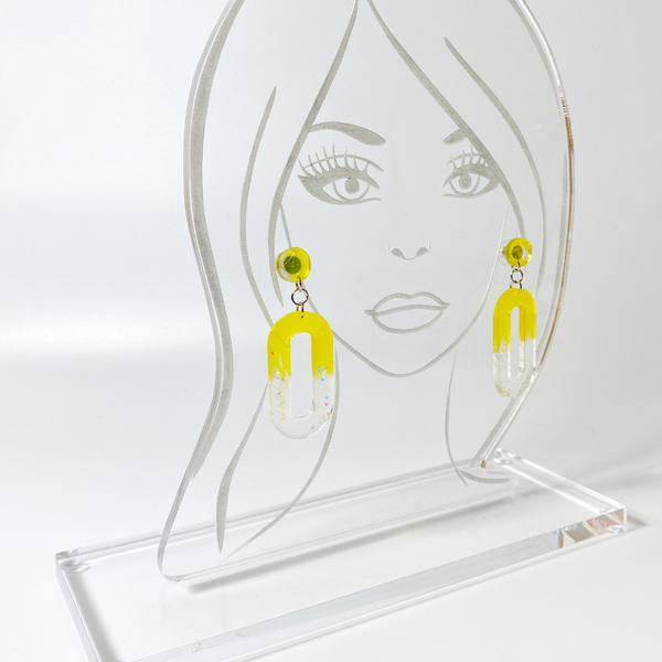 Sunrise earrings on acrylic head display